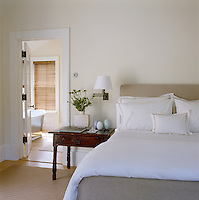 In the contemporary bedroom a 17th century French oak table displays egg-shaped ceramics by Ted Mueling
