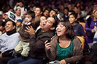 Fans cheer during a match. Lucha Libre is a style of wrestling started in Mexico in 1933. The name means Free Fight, and matches tend to be focussed on spectacle and theatre with fans cheering for their favourite characters, who wear masks while jumping from the ropes, flipping opponents, and occasionally crashing into the crowd..&copy;Jacob Silberberg/Panos/Felix Features.