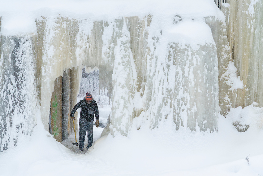 Peter Zenti of the Noquemanon Trails Network clears a tunnel of ice along the North Snow Bike Route in Marquette, Michigan.