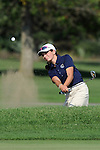 ICCP golfer Maddie Hurt muscles  one out of the bunker on the first green at Fresh Meadows.