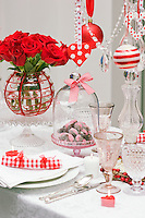 Each place setting has a red and white checked napkin echoing the decorative them of the dining table
