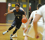 Eagle River's Daniel Toribio weaves his way through Dimond defenders.  Photo for the Star by Michael Dinneen