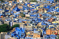 """Jodhpur Rajasthan India. The city is known as the """"Sun City"""" for the bright, sunny weather it enjoys all the year round. It is also referred to as the """"Blue City"""" due to the vivid blue-painted houses around the Mehrangarh Fort. The old city circles the fort and is bounded by a wall with several gates."""