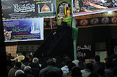 IRAQ, SULAIMANIYAH:  An imam tells the story of Ashura to the gathered Shia worshippers...Around 500 hundred worshipers, many of them internally displaced Arabs, celebrated the Shia holiday of Ashura--the mourning of the death of the grandson of the Islamic prophet Mohammed.  ..Photo by Kamaran Najm/Metrography