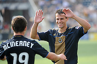 Stefani Miglioranzi (6) of the Philadelphia Union celebrates at the final whistle with Jack McInerney (19). The Philadelphia Union defeated Toronto FC 2-1 on a second half stoppage time goal during a Major League Soccer (MLS) match at PPL Park in Chester, PA, on July 17, 2010.