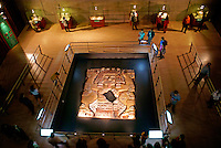 People at the Tlaltecuhtli sculpture exhibit  in the Templo Mayor Museum, Mexico City