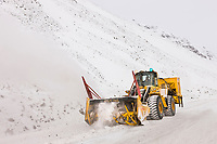 State of Alaska department of transportation snow plow clears the James Dalton Highway at Atigun Pass in the Brooks range, Alaska.
