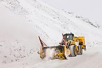 State of Alaska department of transportation snow plow clears the James Dalton Highway at Atigun Pass in the Brooks range, Alaska.