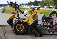 Aug 16, 2014; Brainerd, MN, USA; Members of the Safety Safari help NHRA top alcohol dragster driver Dean Dubbin off the track during qualifying for the Lucas Oil Nationals at Brainerd International Raceway. Mandatory Credit: Mark J. Rebilas-