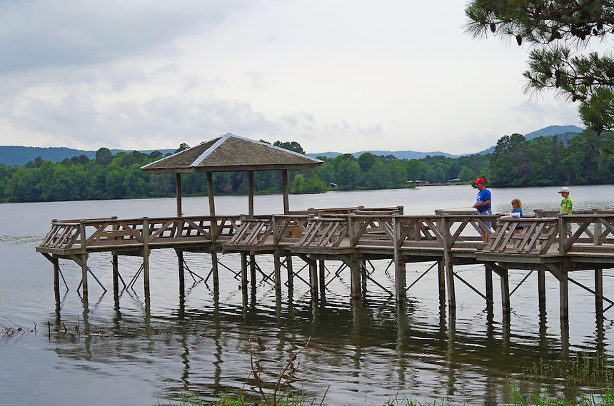Father and kids fishing from a pier on Lake Hamilton, Arkansas