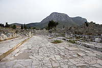 : A general view of the Lechaion Road,  in Corinth, Greece. The marble paved road, seen here with the mountains in the background, linked Corinth to the port of Lechaion and was lined with shops. Corinth, founded in Neolithic times, was a major Ancient Greek city, until it was razed by the Romans in 146 BC.