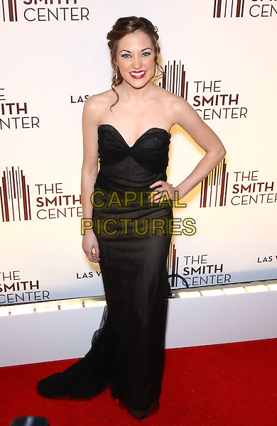 Laura Osnes.Grand opening of The Smith Center for the Performing Arts, Las Vegas, Las Vegas, Nevada, USA, .10th March 2012..full length strapless black dress hand on hip long maxi  .CAP/ADM/MJT.© MJT/AdMedia/Capital Pictures.