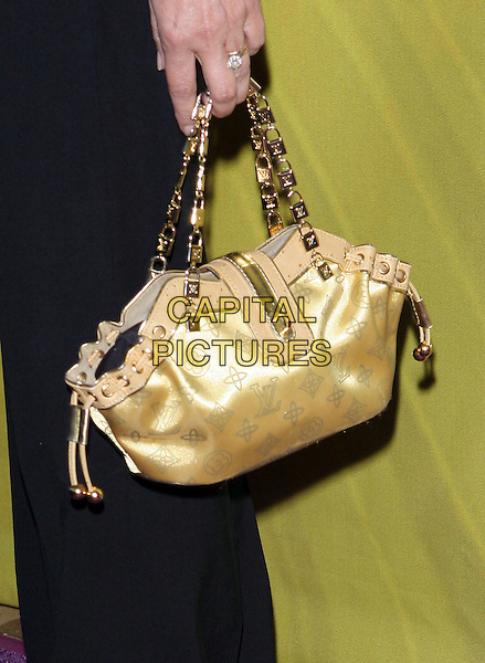 CHERYL LADD'S PURSE.Las Vegas Cocktail Party held at The Beverly Hilton, Beverly Hills, CA..July 24th, 2005.Photo credit: Jacqui Wong/AdMedia.yellow gold silk satin louis vuitton bag purse gold lock straps.www.capitalpictures.com.sales@capitalpictures.com.© Capital Pictures.