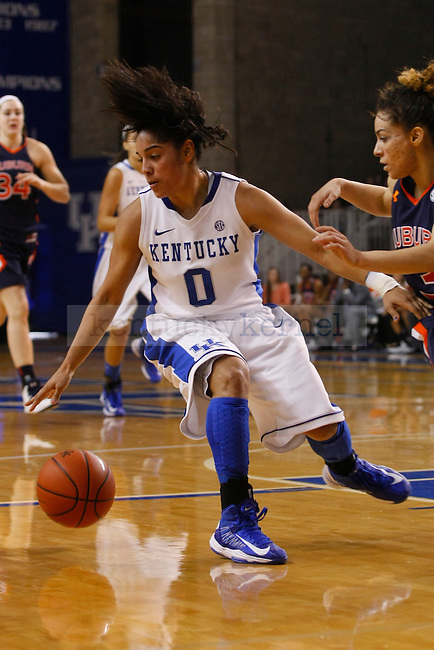 UK guard Jennifer O'Neill dribbles the ball away from Auburn guard Najat Ouardad during the second half of the UK Hoops vs. Auburn women's basketball game at Memorial Coliseum in Lexington, Ky., on Sunday, January 20, 2013. Photo by Tessa Lighty | Staff