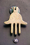 A door with a hamsa shaped knocker, Essaouira, Morocco.
