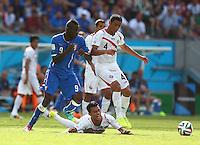 Mario Balotelli of Italy fouls Giancarlo Gonzalez of Costa Rica