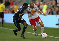 CHESTER, PA - OCTOBER 27, 2012:  Raymon Gaddis (28) of the Philadelphia Union holds on to  Joel Lindpere (20) of the New York Red Bulls during an MLS match at PPL Park in Chester, PA. on October 27. Red Bulls won 3-0.