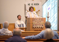NWA Democrat-Gazette/ANTHONY REYES &bull; @NWATONYR<br /> Rev. Pamela Morgan, rector at St. Thomas Episcopal Church, gives sermon Thursday, May 14, 2015 as Rev. Clint Schnekloth, pastor at Good Shepherd ECLA Church in Fayetteville, and others listen during the Ascension Day service at St. Thomas Episcopal in Springdale. The church held a joint worship service with Good Shepherd and other local churches.