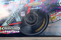 Jun 6, 2016; Epping , NH, USA; Detailed view of the rear Goodyear tire of NHRA funny car driver Courtney Force as she does a burnout during the New England Nationals at New England Dragway. Mandatory Credit: Mark J. Rebilas-USA TODAY Sports
