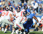 Ole Miss' Randall Mackey (1) is sacked by Kentucky's Mark Crawford (98) at Commonwealth Stadium in Lexington, Ky. on Saturday, November 5, 2011. ..