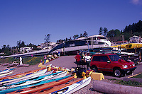 Kayaks on Beach at Semiahoo Bay, White Rock, BC, British Columbia, Canada - Amtrak Train passing by at Railway Crossing