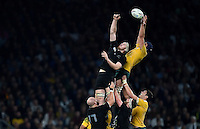 Dean Mumm of Australia looks to claim the ball at a lineout despite the challenge of Brodie Retallick of New Zealand. Rugby World Cup Final between New Zealand and Australia on October 31, 2015 at Twickenham Stadium in London, England. Photo by: Patrick Khachfe / Onside Images