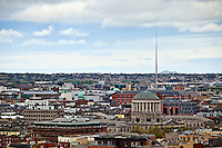 The skyline of Dublin, Ireland can be viewed from the Gravity Bar at the Guinness Storehouse. The Spire of Dublin, officially titled the Monument of Light is visible.