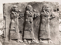 "EXCLUSIVE (b/w photo) Relief depicting a procession of prisonner carrying the tribute of fortificated cities already controled, Temple ou Salle 90 des dépendances, Khorsabad, Iraq, Middle East. Lost at Shatt al-Arab in 1855. See annex Louvre Museum n° 33 to 40. Picture: Victor Place (1818 - 1875)...Additional info :..Khorsabad (Temple ou Salle 90 des dépendances) (N.A. pl. 48-1 ""Fragment d'une procession de captifs apportant le tribut de villes fortifiées soumises. Perdu Chatt el Arab 1855. Voir suite Musée du Louvre N° 33 à 40. Cliché Victor Place."