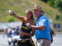 Jun 19, 2016; Bristol, TN, USA; NHRA top fuel driver Leah Pritchett take a selfie photo with a fan during the Thunder Valley Nationals at Bristol Dragway. Mandatory Credit: Mark J. Rebilas-USA TODAY Sports