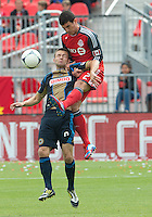 15 September 2012: Philadelphia Union forward Jack McInerney #9 and Toronto FC defender Logan Emory #2 in action during an MLS game between the Philadelphia Union and Toronto FC at BMO Field in Toronto, Ontario..The game ended in a 1-1 draw..