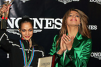 (L) Irina Tchachina of Russia wins Longines Prize for Elegance presented by (R) Alina Kabaeva, 2004 Olympic gold medalist, at press reception after World Championships at Baku, Azerbaijan on October 8, 2005. (Photo by Tom Theobald)