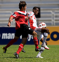 Michael Petrasso (20) of Canada fights for the ball with Kiel Pierre (17) of Trinidad & Tobago during the quarterfinals of the CONCACAF Men's Under 17 Championship at Catherine Hall Stadium in Montego Bay, Jamaica. Canada defeated Trinidad & Tobago, 2-0.