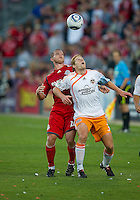 01 July 2010:  Houston Dynamo defender Andrew Hainault #31 and Toronto FC forward Chad Barrett #19 in action during a game between the Houston Dynamo and the Toronto FC at BMO Field in Toronto..Final score was 1-1....