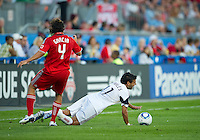 August 28 2010 Toronto FC defender Nick Garcia #4 fouls Real Salt Lake midfielder Javier Morales #11 during a game between Real Salt Lake and Toronto FC at BMO Field in Toronto..The game ended in a 0-0 draw.