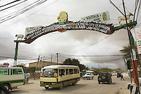 """Somaliland. Waqohi Galbed province. Hargeisa town center. Traffic on the main road. Public buses and dust. Advertising for companies, like """" Desert eagle welcomes you to the city of Hargeisa"""", or """" Vatika hair oil"""". Somaliland is an unrecognized de facto sovereign state located in the Horn of Africa. Hargeisa is the capital of Somaliland. © 2006 Didier Ruef"""