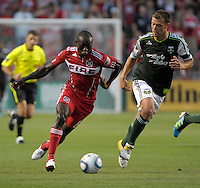 Chicago forward Dominic Oduro (8) speeds toward the Portland goal while Portland midfielder Jack Jewsbury (13) gives chase.  The Portland Timbers defeated the Chicago Fire 1-0 at Toyota Park in Bridgeview, IL on July 16, 2011.