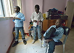 Refugee boys get dressed in the morning before going to a school operated by St. Andrew's Refugee Services in Cairo, Egypt. The school is supported by Church World Service.