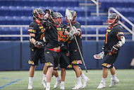 Annapolis, MD - February 11, 2017: Maryland Terrapins Austin Henningsen (18) celebrates with teammates after scoring a goal during game between Maryland vs Navy at  Navy-Marine Corps Memorial Stadium in Annapolis, MD.   (Photo by Elliott Brown/Media Images International)