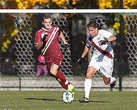 Virginia Tech midfielder Niels Kirch (10) works to clear ball as Boston College forward Cole DeNormandie (23) defends.Boston College (maroon) defeated Virginia Tech (Virginia Polytechnic Institute and State University) (white), 3-1, at Newton Campus Field, on November 3, 2013.