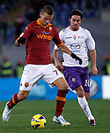 Calcio, Serie A: Roma vs Fiorentina. Roma, stadio Olimpico, 8 dicembre 2012..AS Roma midfielder Panagiotis Tachtsidis, of Greece, is challenged by Fiorentina midfielder Alberto Aquilani, right, during the Italian Serie A football match between AS Roma and Fiorentina at Rome's Olympic stadium, 8 december 2012..UPDATE IMAGES PRESS/Isabella Bonotto