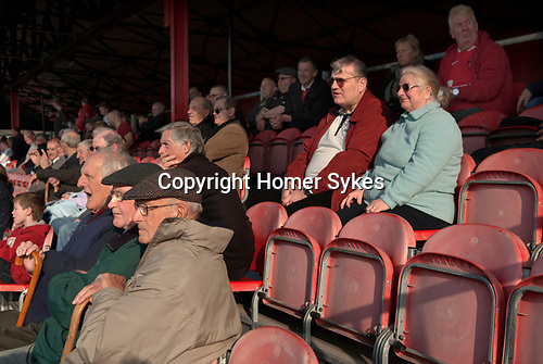 "The Fleet football team supporters at the ""home end"". Ebbsfleet v Tunbridge. Ebbsfleet Valley Kent UK.   2014."