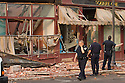 Police officers and firefighters search buildings on Main St in downtown Springfield, MA where a tornado struck on Wednesday afternoon June 1, 2011.  (Matthew Cavanaugh for The Boston Globe)