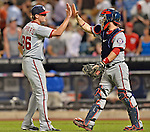 24 July 2012: Washington Nationals pitcher Tyler Clippard gets a high-five from catcher Jesus Flores after a game against the New York Mets at Citi Field in Flushing, NY. The Nationals defeated the Mets 5-2 to take the second game of their 3-game series. Mandatory Credit: Ed Wolfstein Photo