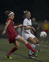 Boston University defender Erin Mullen (7) clears the ball as Boston College forward/midfielder Gibby Wagner (10) defends. After 2 complete overtime periods, Boston College tied Boston University, 1-1, after 2 overtime periods at Newton Soccer Field, August 19, 2011.