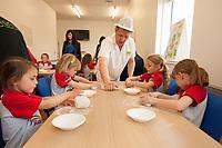 ASDA Newark baker Mark Smith shows the Rainbows how to knead dough