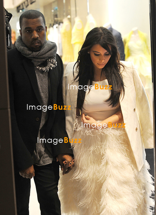 KIM KARDASHIAN GETS $65,000 IN JEWELRY FROM KANYE WEST /January 25, 2013-Kim Kardashian and Kanye West are shopping at the Hermès, Cartier, Lanvin and Ermmano Scervino, in Paris, France..Kim Kardashian Gets $65,000 in Jewelry from Kanye West.while shopping at Hermès, Cartier, Lanvin and Ermmano Scervino stores in Paris. Kanye West offered to Kim : the Cartier Panthere Bracelet (embedded with diamonds), a yellow gold Cartier Love Bracelet with diamonds ($9,400), and the Cartier Juste un Clou, said to cost $34,650, plus two animal print bracelets -- with an estimated total of $65,000..