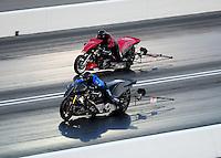 Jun. 17, 2011; Bristol, TN, USA: NHRA top fuel Harley motorcycle rider Jay Turner (near) races Mike Scott during qualifying for the Thunder Valley Nationals at Bristol Dragway. Mandatory Credit: Mark J. Rebilas-