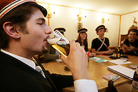 Switzerland. Canton Graubunden. Surselva area. Disentis. Desertina student association. Ayoung man drinks a glass of beer.  © 2006 Didier Ruef