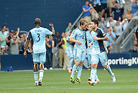 Kansas City players celebrate equalizing goal..Sporting Kansas City and Houston Dynamo played to a 1-1 tie at Sporting Park, Kansas City, Kansas.