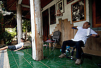 Dr. Jose Ramos- Horta, East Timor's president  and Nobel Peace Prize winner (right) performs his morning exercises with a friend in his home near Dili, Timor-Leste on Monday, Oct. 3rd, 2011.  Photographer: Daniel J. Groshong/The Hummingfish Foundation